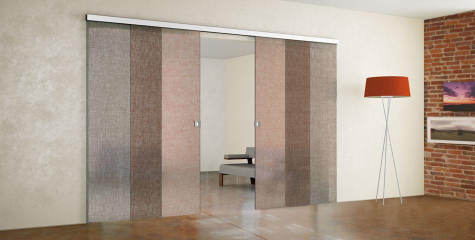 Porte da interno in vetro scorrevoli moderne e decorate a terni - Porte scorrevoli in vetro a scomparsa ...