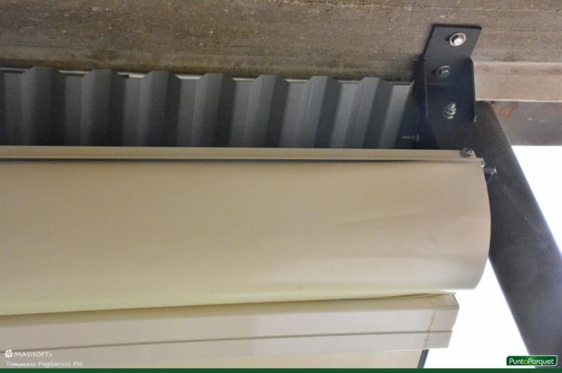 Pergola in alluminio con telo in PVC motorizzato